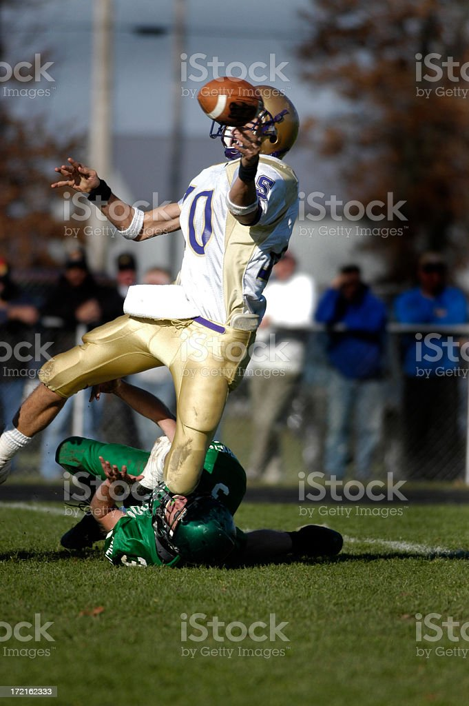 American Football player about to catch a football stock photo