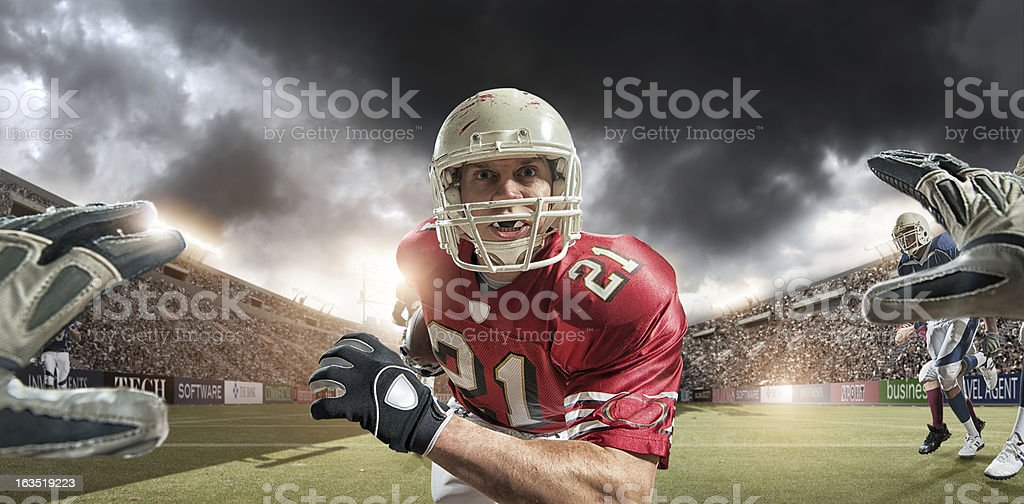 POV American Football Player About to Tackle stock photo