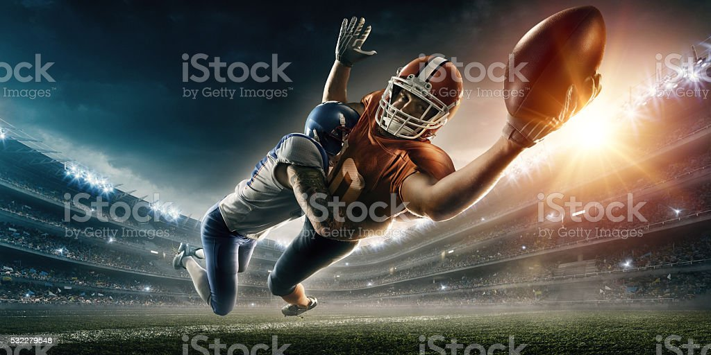 American football player being tackled stock photo