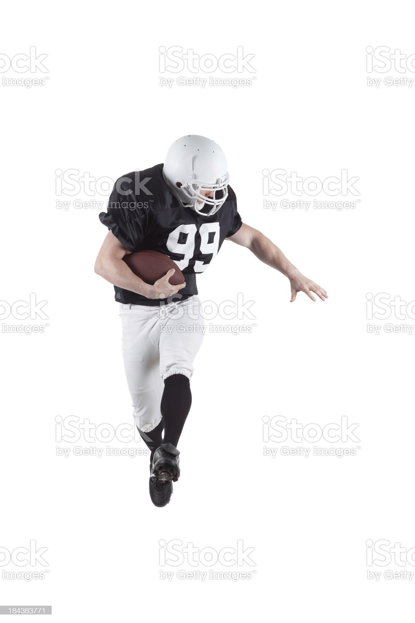 American football player carrying a rugby royalty-free stock photo