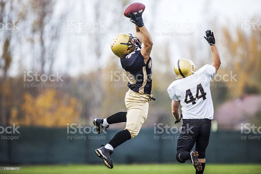 American football player catching a ball. stock photo