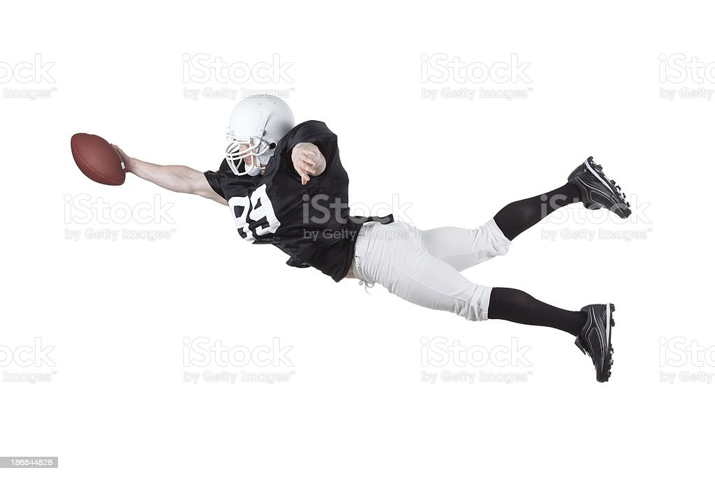 American football player catching a ball royalty-free stock photo
