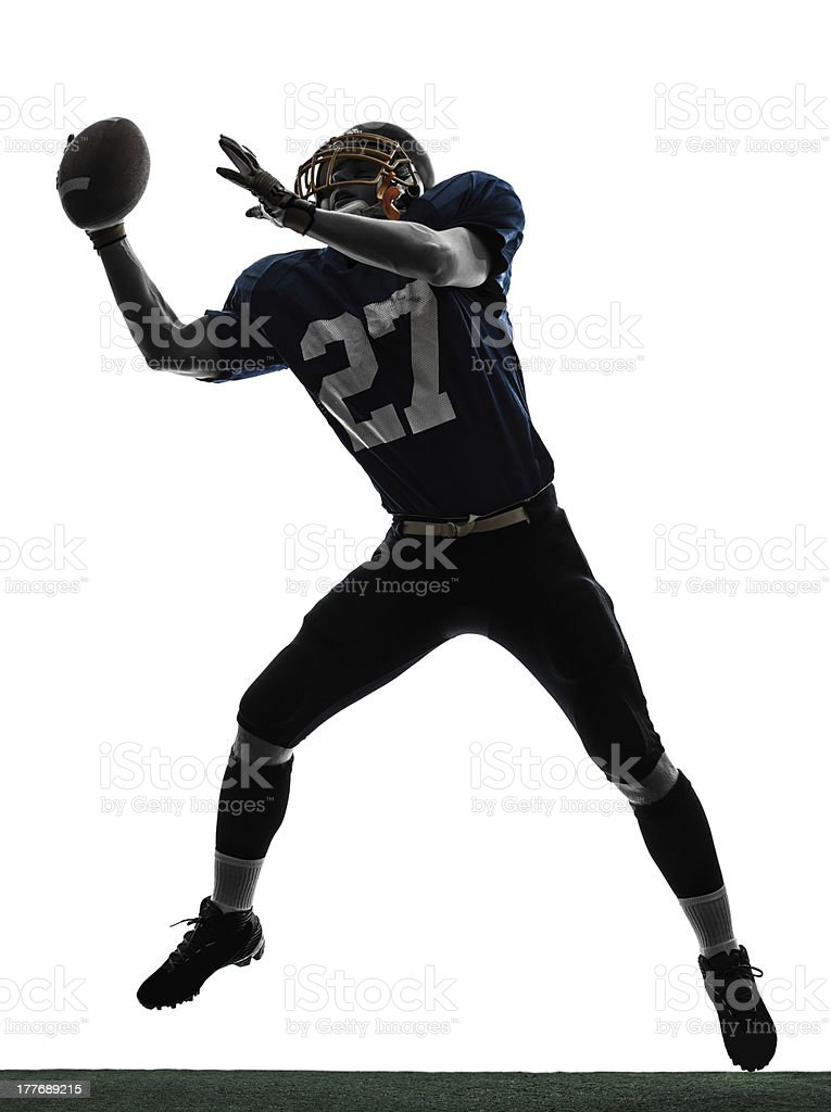 American football player catching ball stock photo