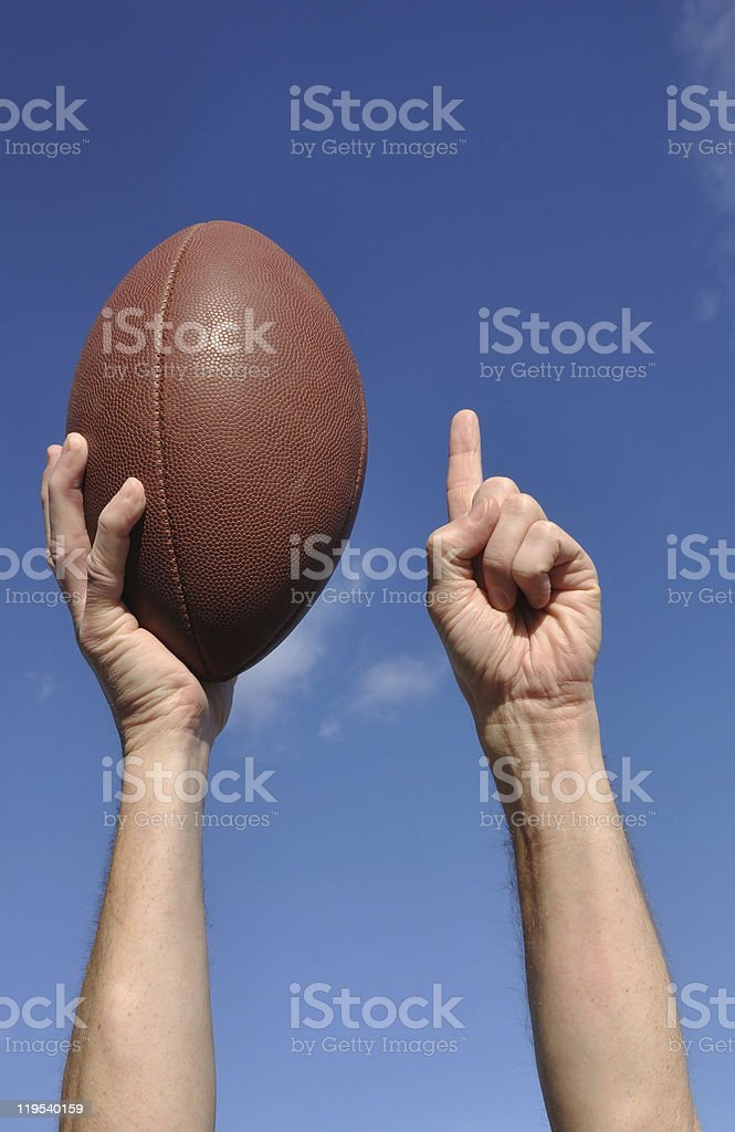 American Football Player Celebrates a Touchdown royalty-free stock photo