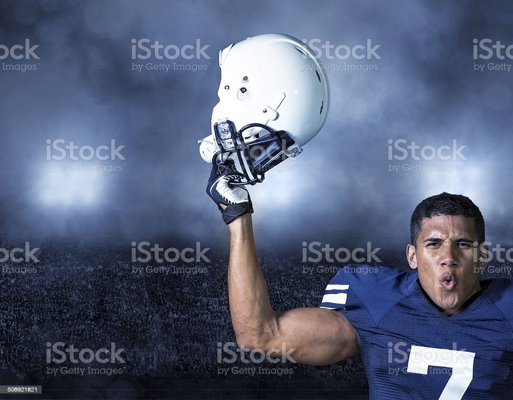 American Football Player celebrating a win stock photo