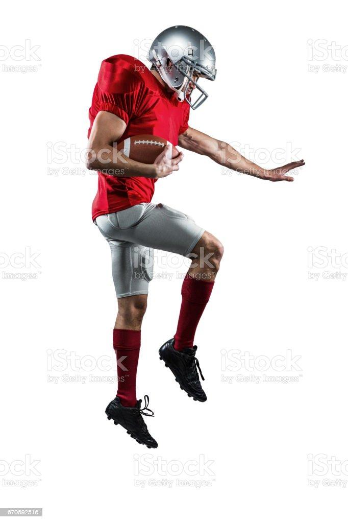 American football player defending stock photo