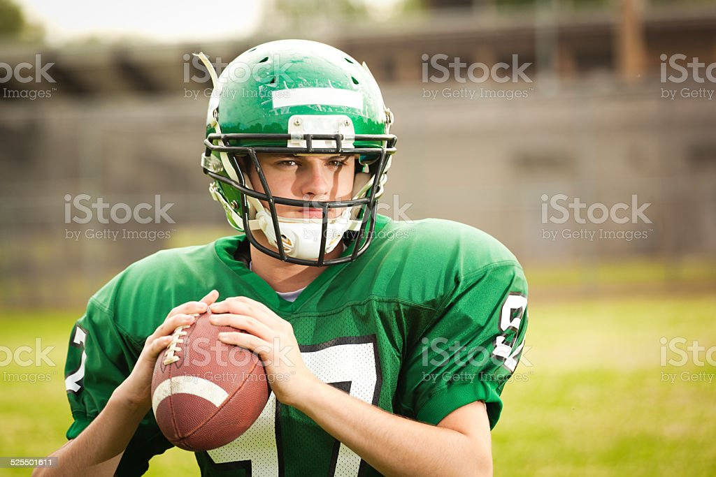 American Football Player, High School Quarterback Ready to Throw Pass stock photo