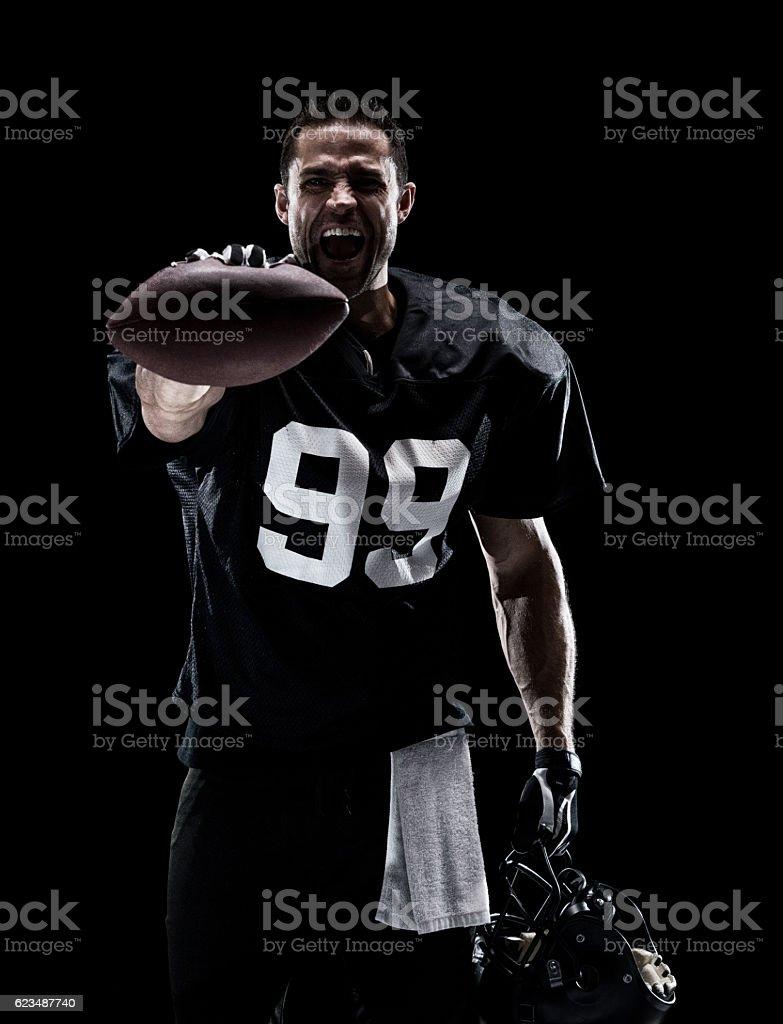 American football player holding ball stock photo