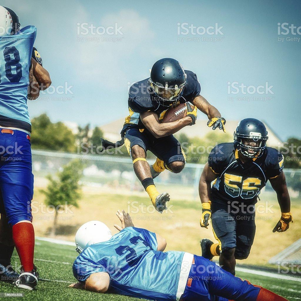 American Football Player Jumping stock photo