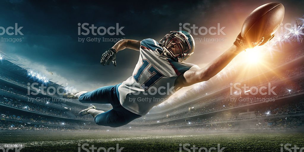 American football player jumping stock photo