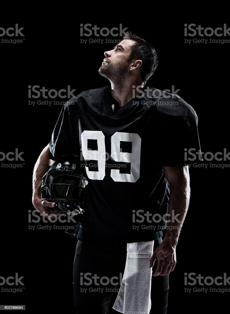 American football player looking up stock photo