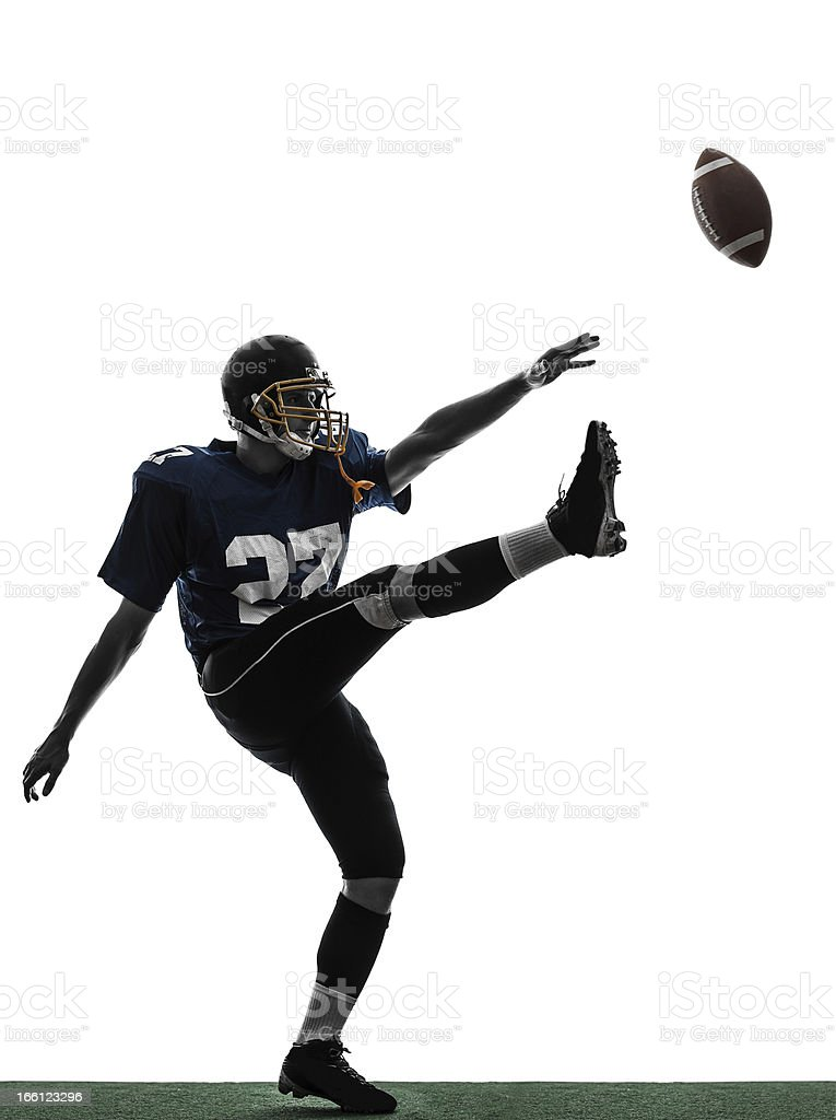 american football player man kicker kicking silhouette stock photo