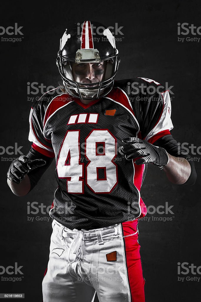 American football player on dark background stock photo