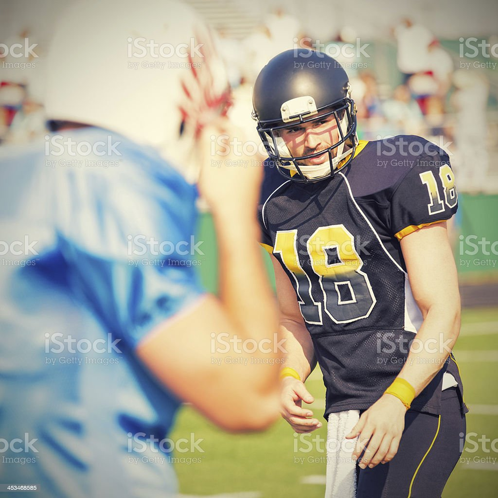 American football player on field during pro game royalty-free stock photo