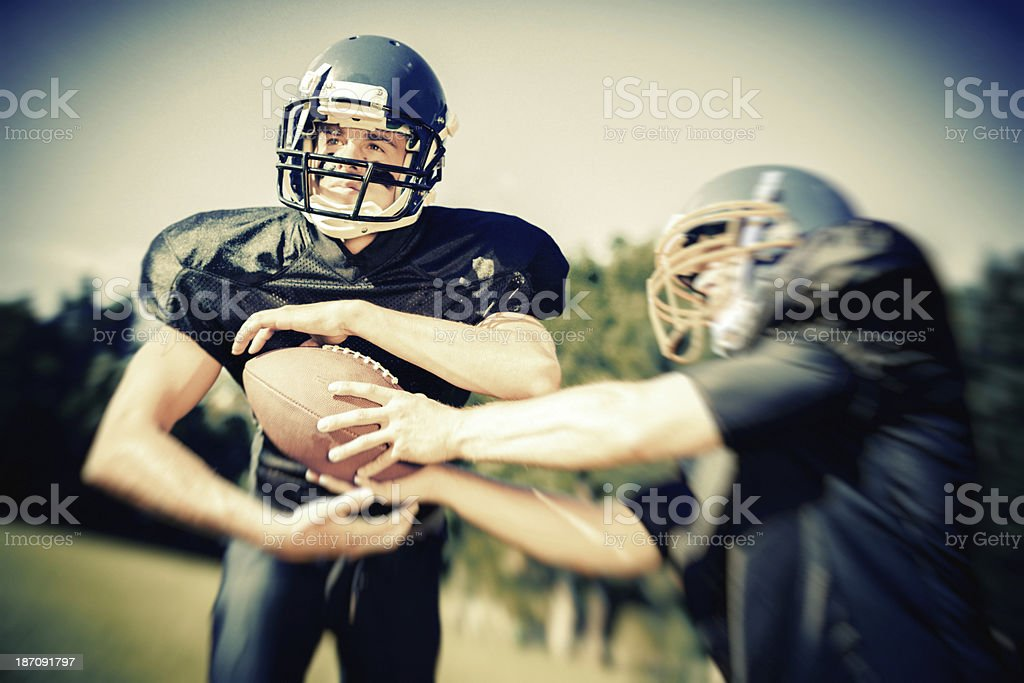 american football player passing the ball royalty-free stock photo