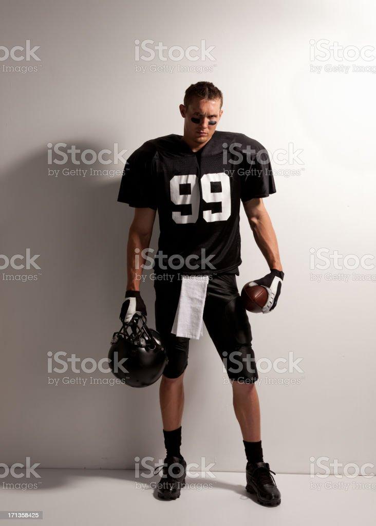 American football player posing stock photo