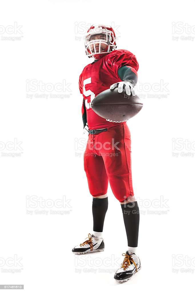 American football player posing with ball on white background stock photo