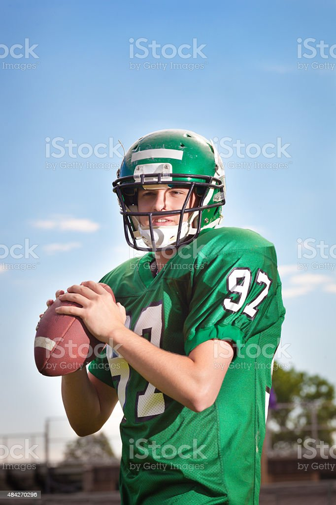 American Football Player Quarterback Throwing a Pass Close-up stock photo