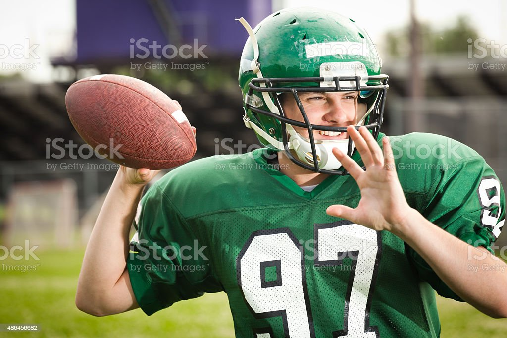 American Football Player Quarterback Throwing a Pass Close-up stock photo