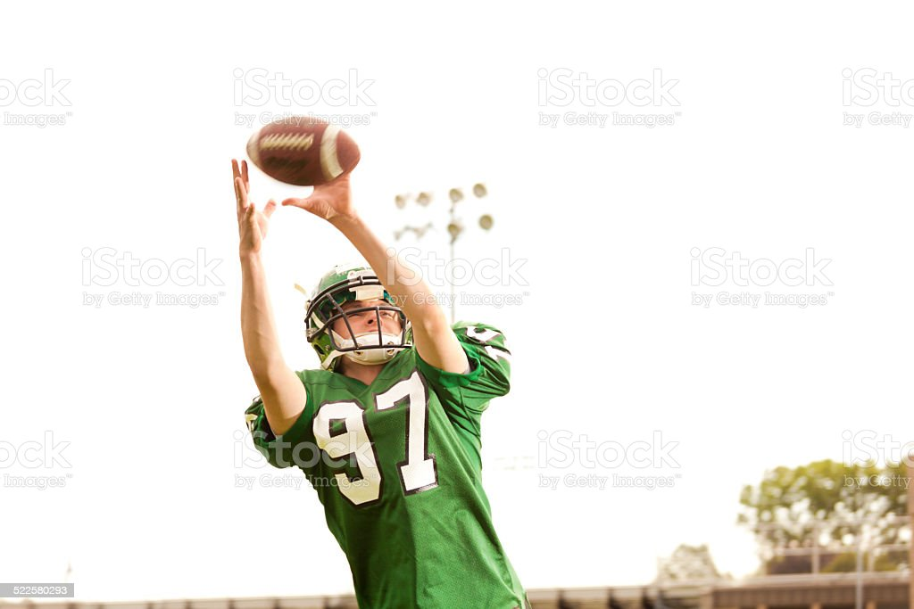 American Football Player Receiver in Action stock photo