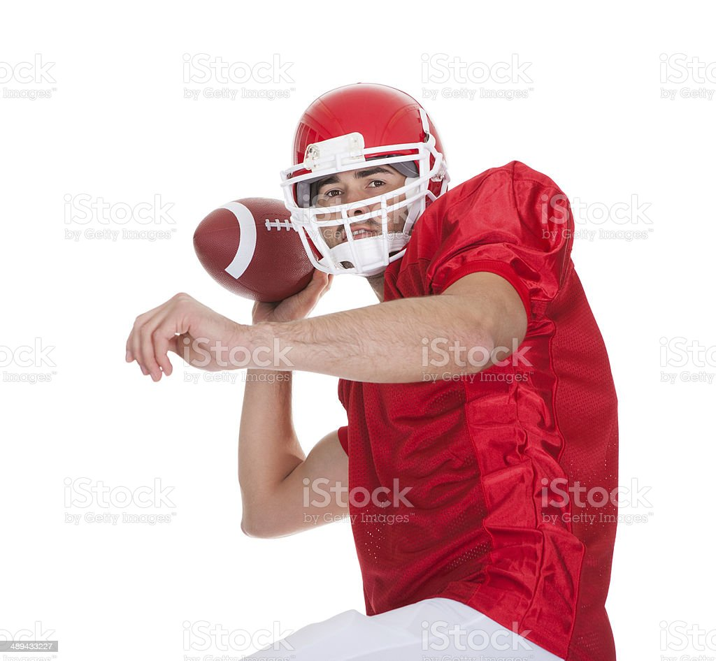 American Football player running with ball stock photo