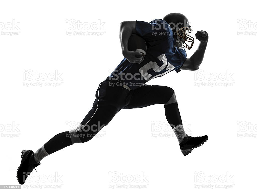 American football player running with the ball stock photo