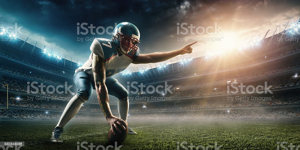 American football player stand stock photo