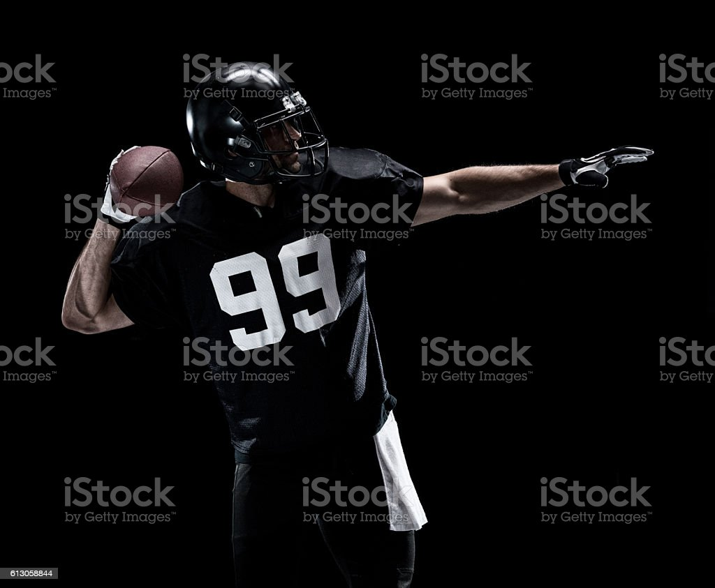 American football player throwing stock photo
