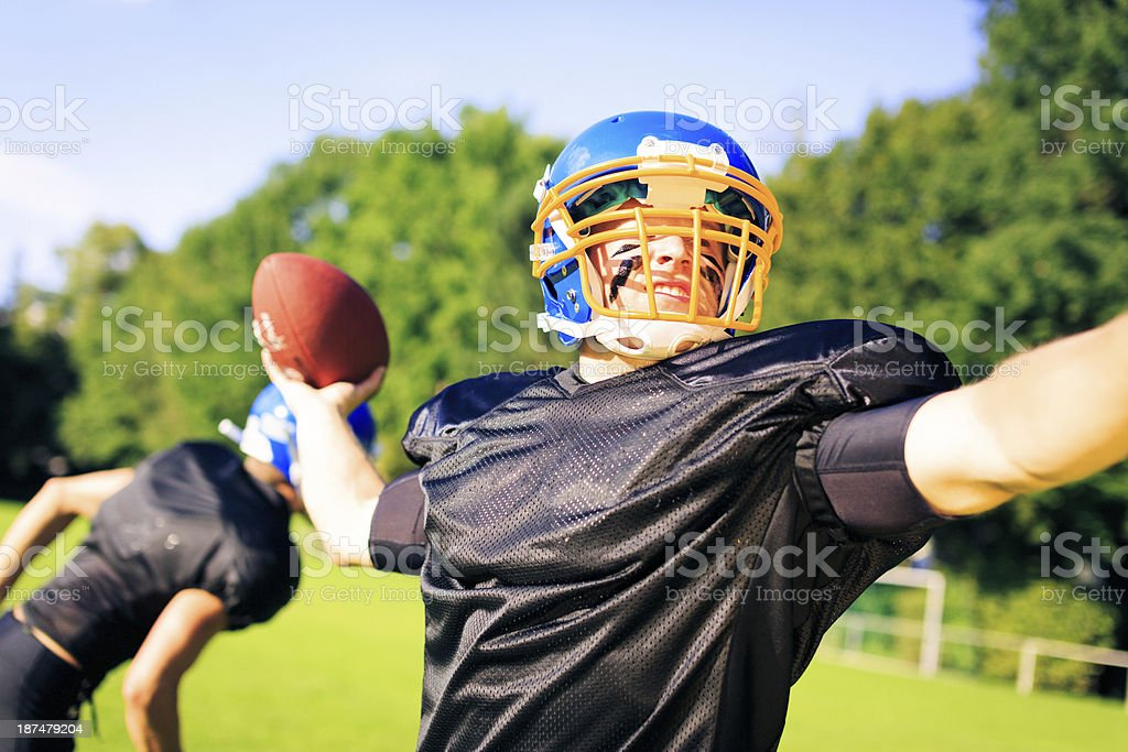 american football player throwing the ball royalty-free stock photo