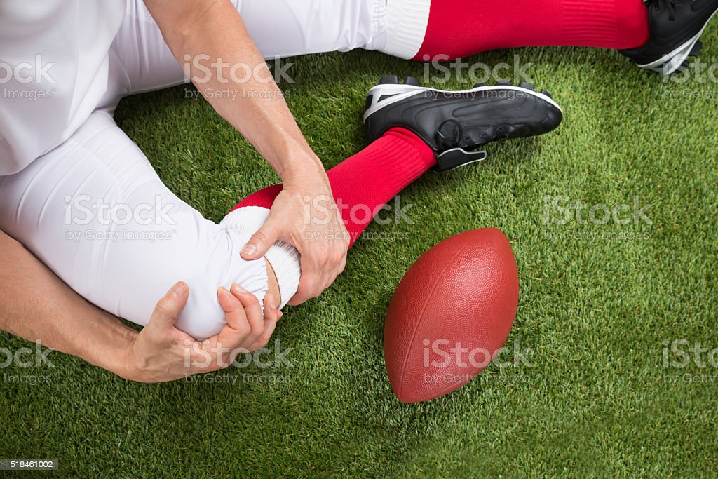 American Football Player With Injury In Leg stock photo