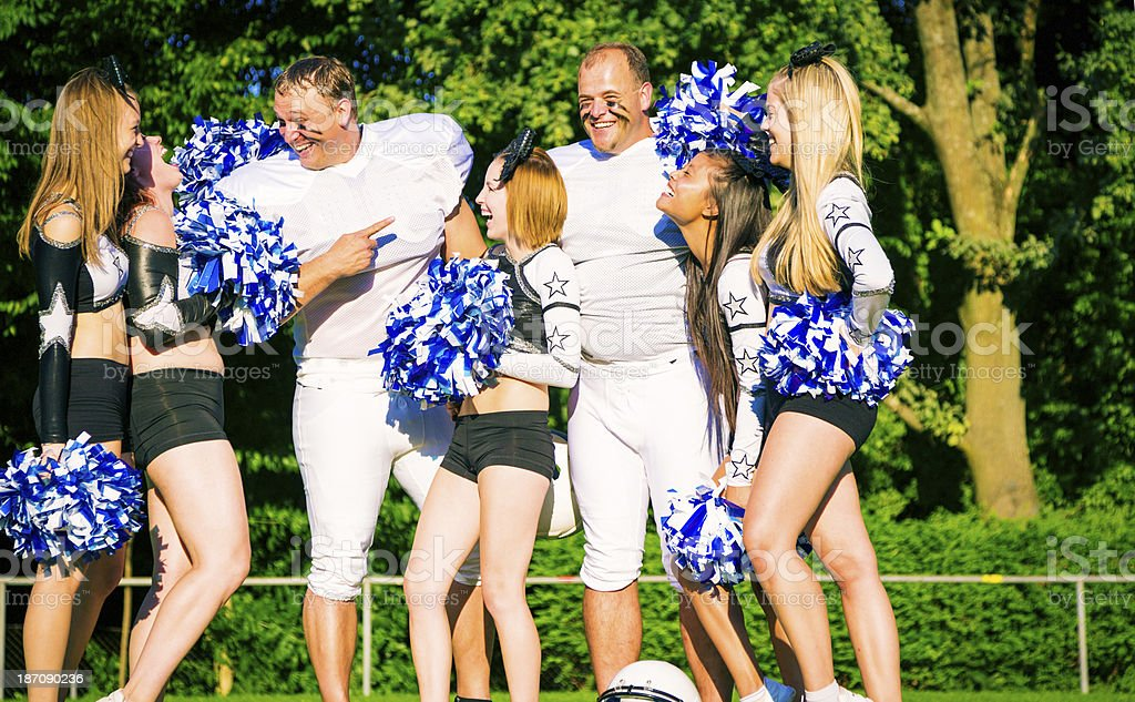 american football players and cheerleaders royalty-free stock photo
