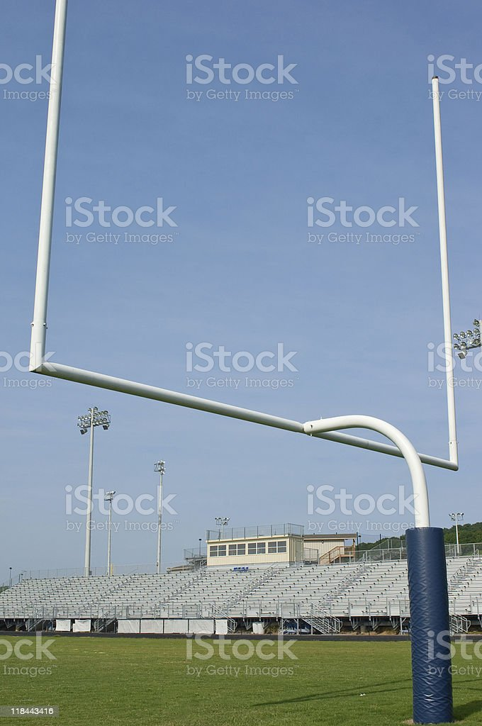 American Football Players at Football Game on Football Field royalty-free stock photo
