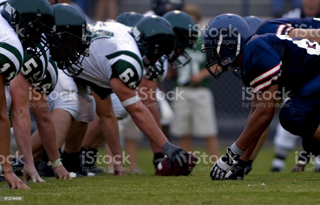 American Football Players at Line of Scrimmage during Football Game stock photo