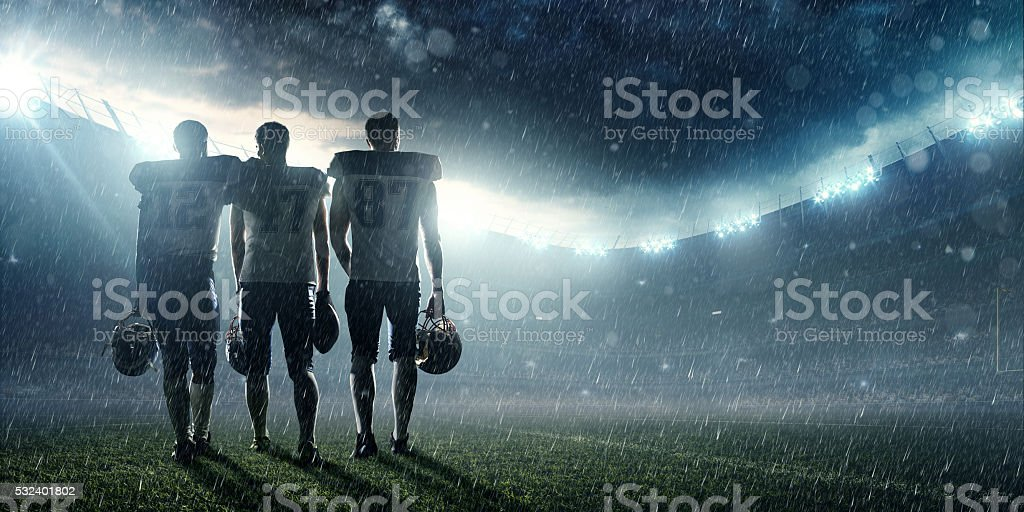 American football players at the end of the game stock photo