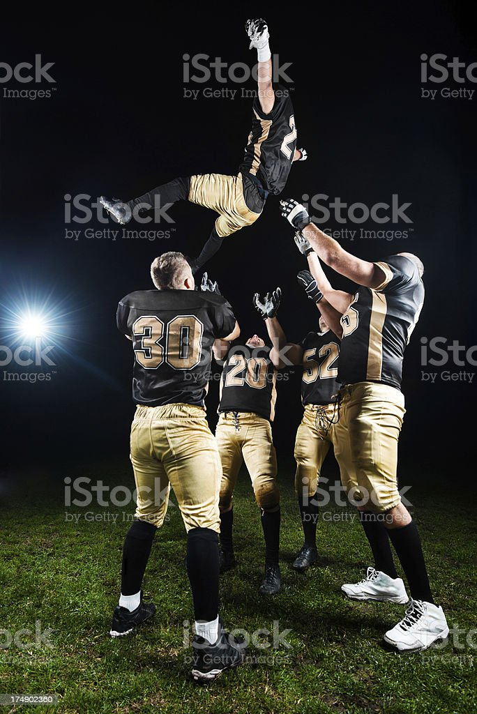 American Football Players celebrating their victory. stock photo