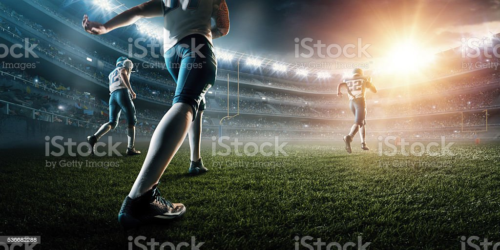 American football players enter the stadium stock photo