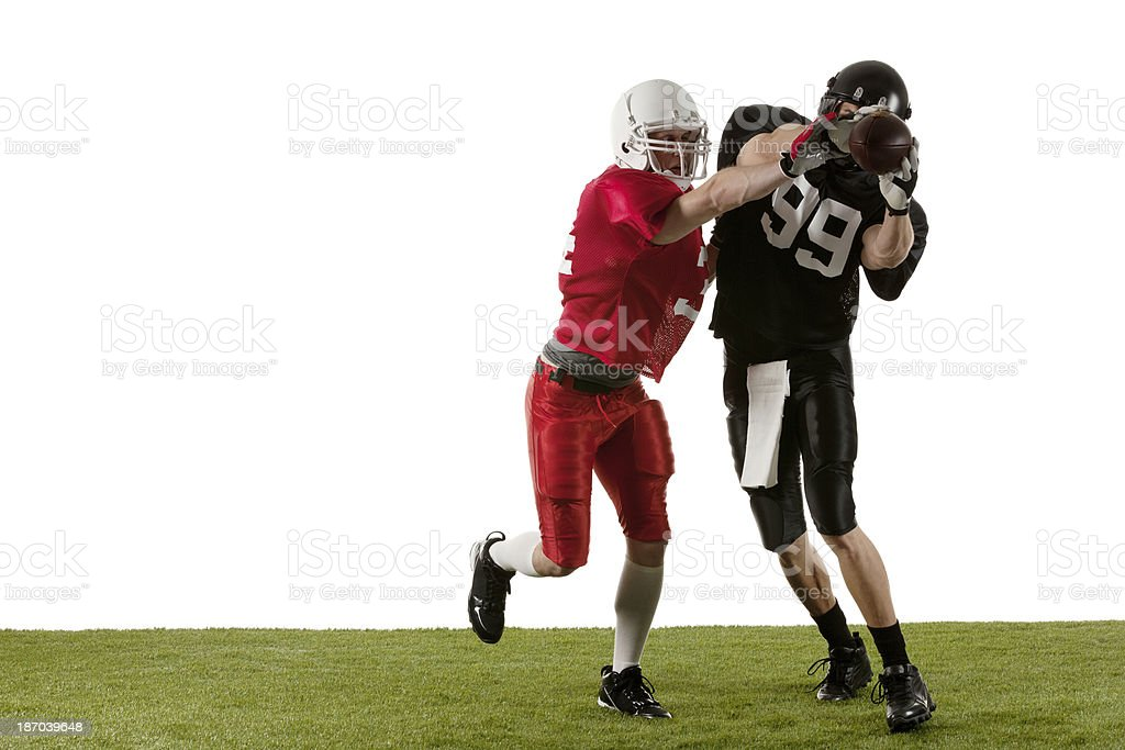 American football players in action stock photo