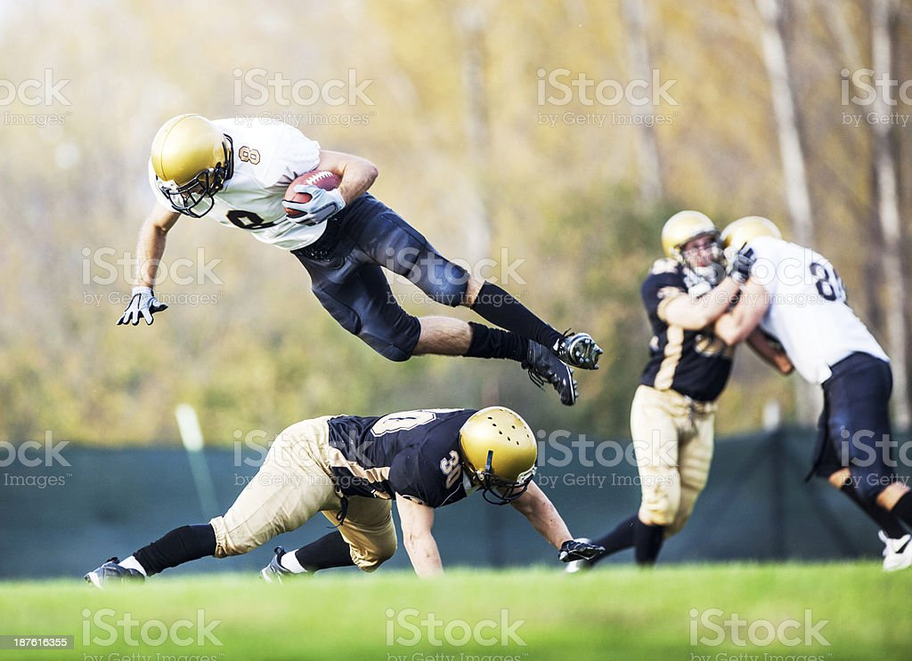 American football players in action. stock photo
