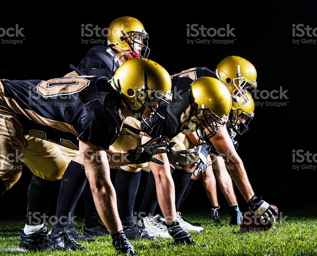 American football players lining up. stock photo