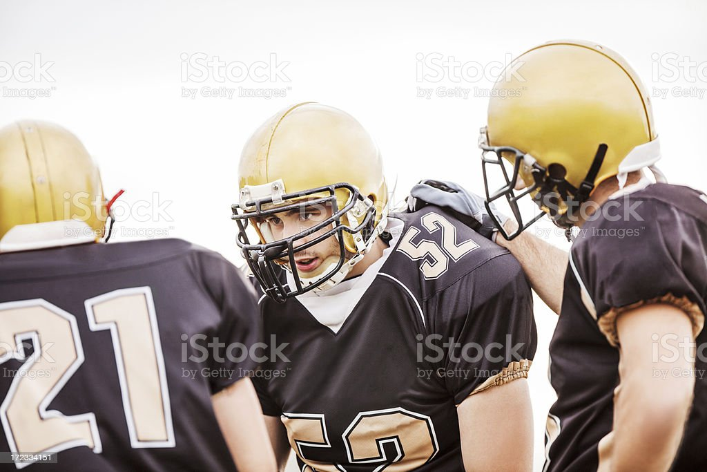 American football players making a plan. royalty-free stock photo