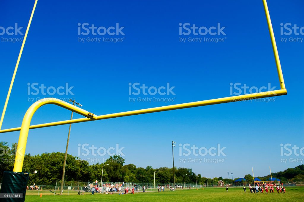 American Football Players on Football Field at Football Game royalty-free stock photo
