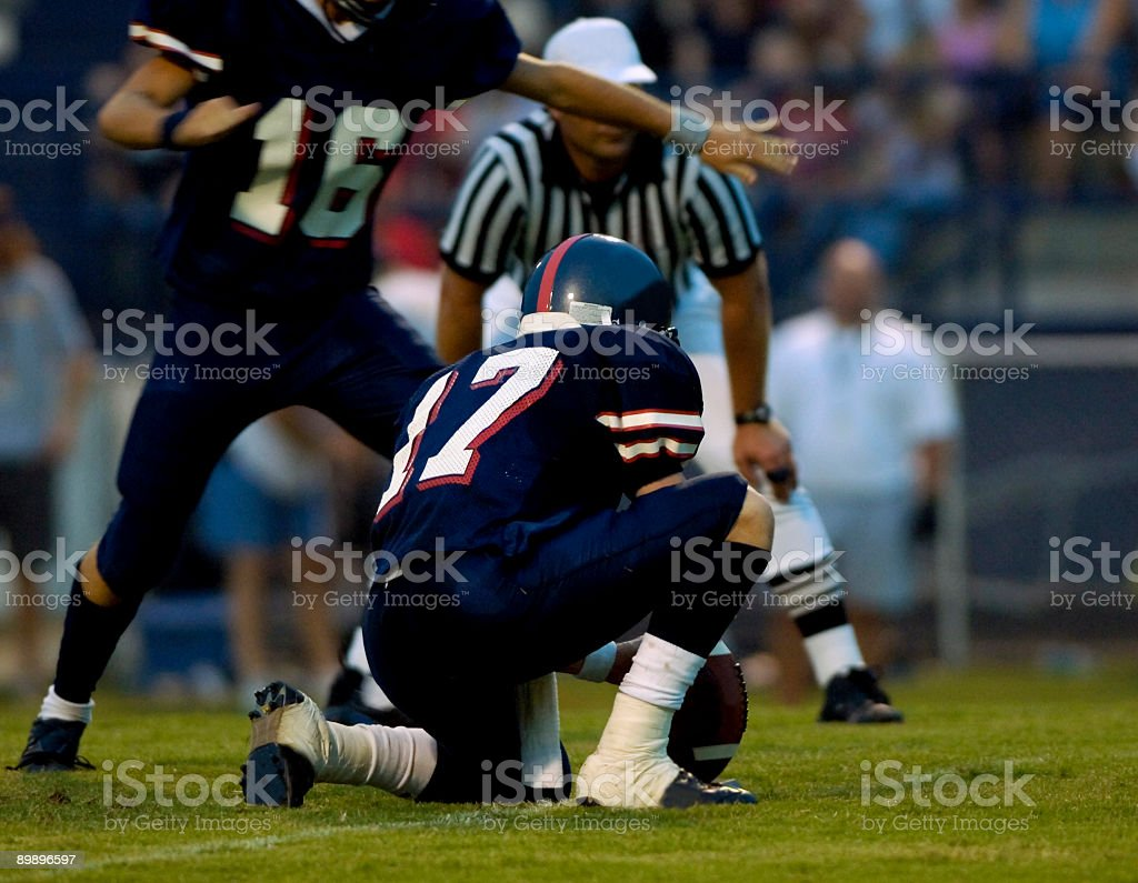American Football Players Playing a Football Game on Football Field royalty-free stock photo