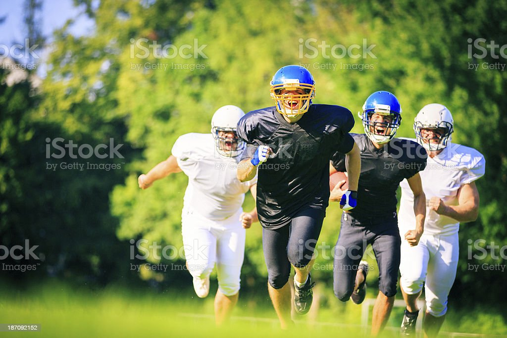 american football players running royalty-free stock photo