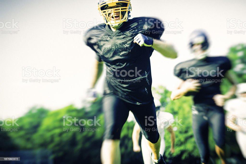 american football players running royalty-free stock photo