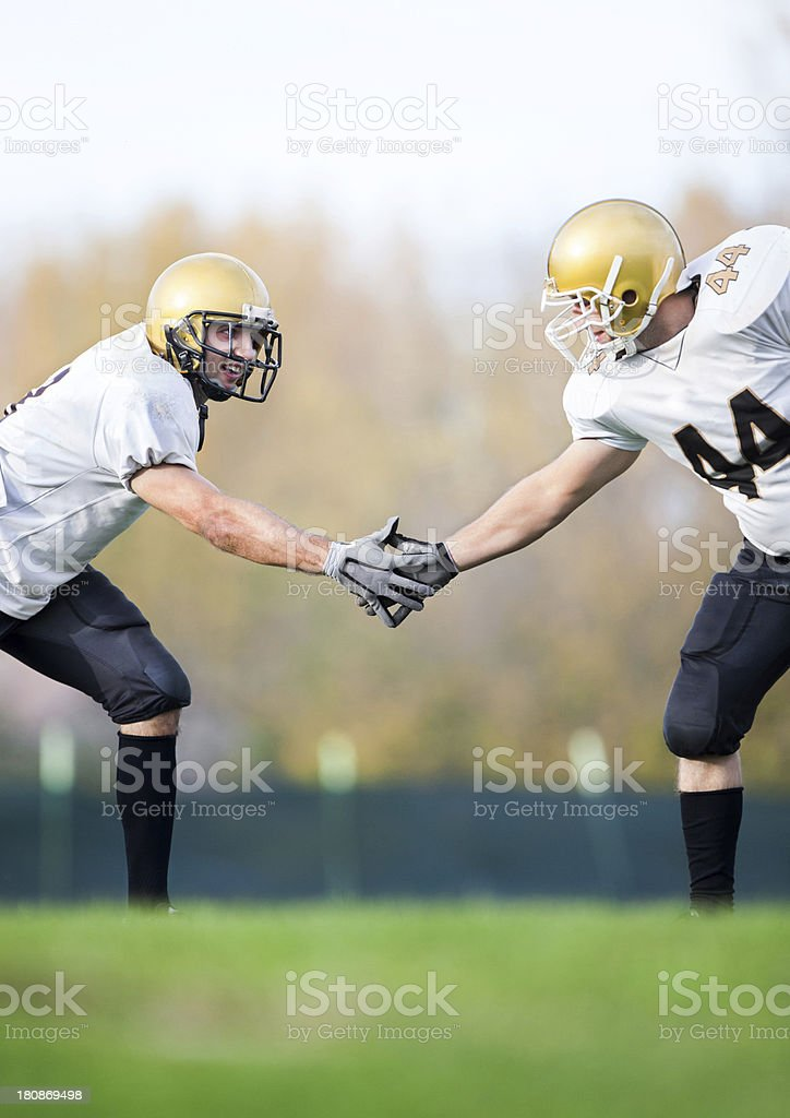 American football players shaking hands. royalty-free stock photo