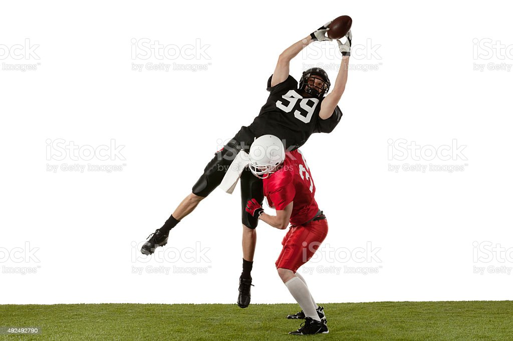 American football players tackling stock photo