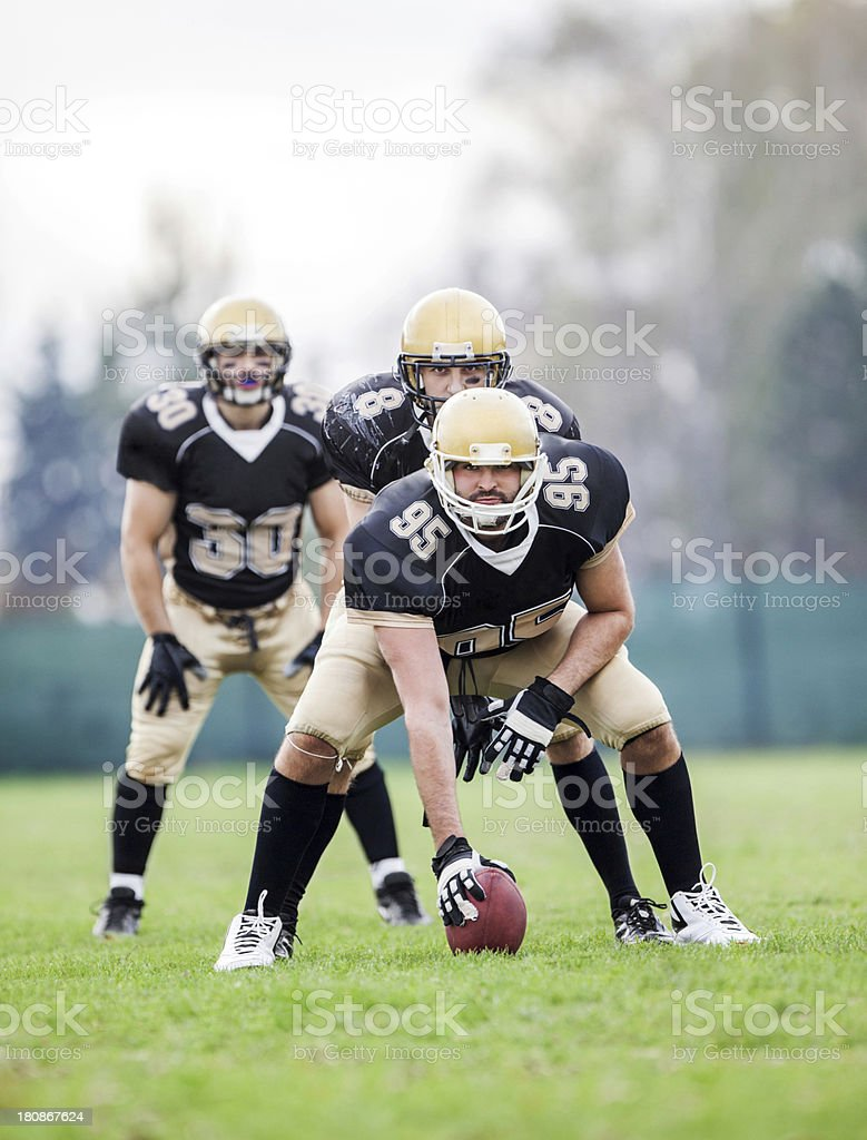 American football players taking their position. royalty-free stock photo