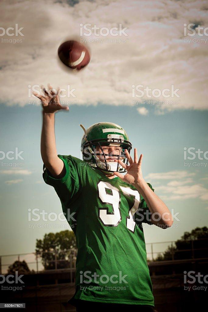 American Football Quarterback Passing the Ball stock photo