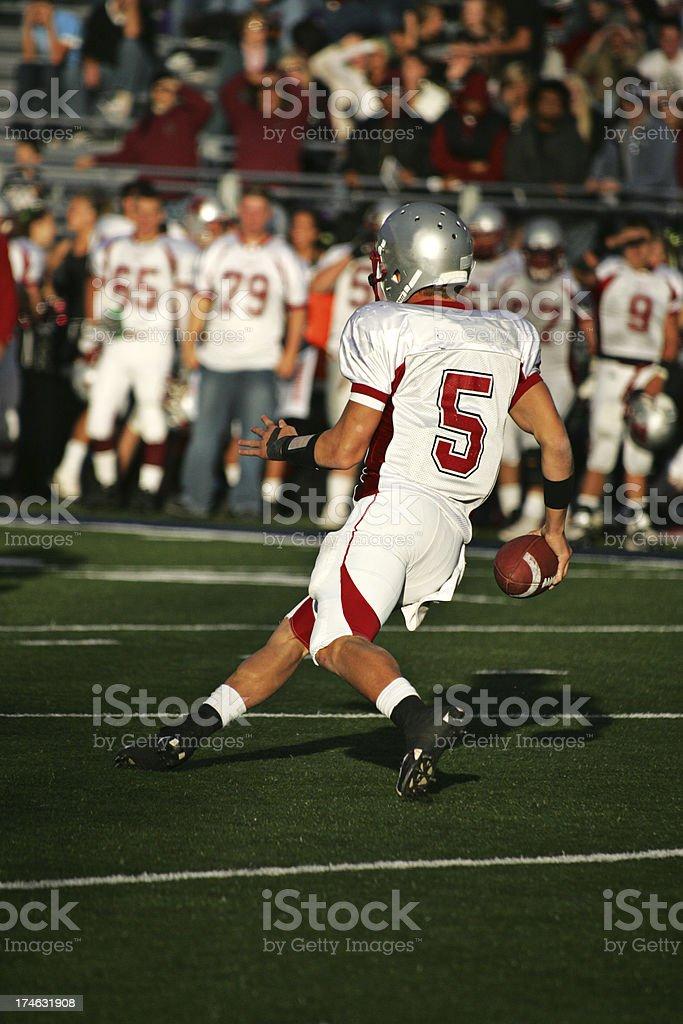 American Football Quarterback Scrambles for Short Gain stock photo