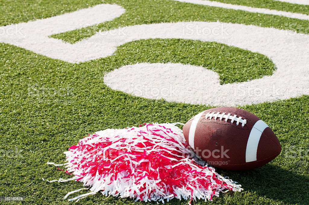 American football, red pompom on field with painted number 5 royalty-free stock photo